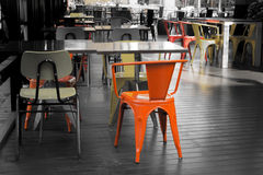 Red chairs in an outdoor restaurants in a dull atmosphere Stock Images