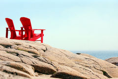 Red chairs by the sea Stock Photos