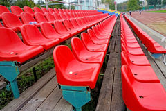 Red chairs in a stadium Royalty Free Stock Photos