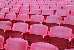Red chairs in the stadium before the show. Red empty chairs in the stadium before the show Royalty Free Stock Image