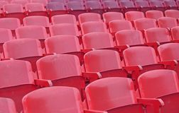 Red chairs in the stadium before the show Stock Photography