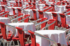Red chairs and tables. Sidewalk cafe chairs and tables in Venice, Italy royalty free stock images