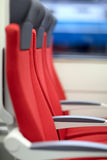 Red chairs in train Stock Image