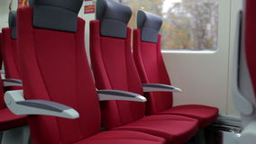 Red chairs in train. stock video