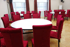 Red chairs and white table Stock Image