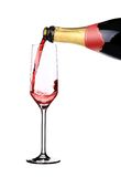 Red champagne pouring in a empty glass. Royalty Free Stock Photo
