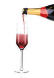 Red champagne pouring in a glass. Royalty Free Stock Image