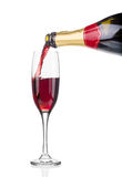 Red champagne pouring in a glass. Royalty Free Stock Photo