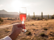Red champagne with sunrise and morning landscape. stock photo