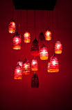 Red chandelier hanging on the ceiling Royalty Free Stock Photography