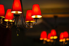 Red chandeliers on the ceiling with five dome lamps. Stock Photo