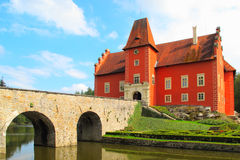 The Red Chateau with stone bridge. Stock Photos