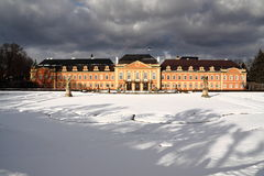 Red chateau under stormy winter sky Royalty Free Stock Image