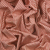 Red check cloth folded. Red gingham check fabric table cloth folded Stock Photo