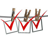 Red check mark. 3d red check mark, hangs on the clothespin Royalty Free Stock Photos