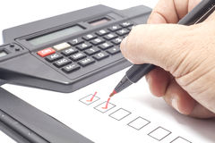 Red check mark. Human hand drawing red check mark in checklist box stock image