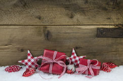 Red Checked Christmas Presents On Wooden Country Style Background. Royalty Free Stock Photo