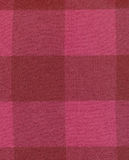 Red checked fabric. Red and pink checked cotton fabric Stock Images