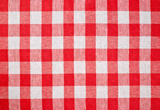Red checked fabric tablecloth. Texture Stock Image