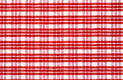Red checked tablecloth. Detail of a red and checked tablecloth Royalty Free Stock Photography
