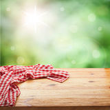 Red checked tablecloth on wooden deck table. Stock Photography