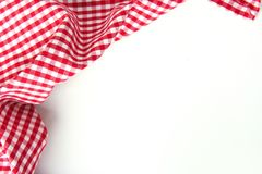 Red checkere clothes on white table empty space background. Royalty Free Stock Photography