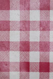 Red checkered background. Very sharp macro picture Royalty Free Stock Photography