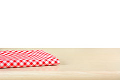 Red checkered cloth on wood table top in white background Stock Photos