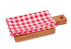 Red checkered cloth  on wooden board . Red checkered cloth  on wooden board  advertisement display design Stock Photos