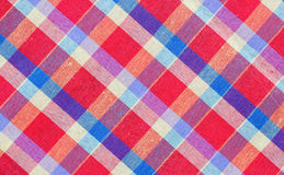 Red checkered fabric tablecloth. Texture background Royalty Free Stock Photography