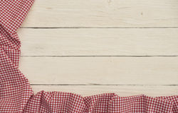 Red checkered fabric on white wooden background. Red checkered fabric with white wooden background Stock Photography