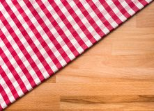 Red checkered fabric on wood table background.For decoration royalty free stock images