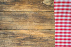 Tablecloth red rustic on brown wooden table. Red checkered fabric on wooden table Royalty Free Stock Photo