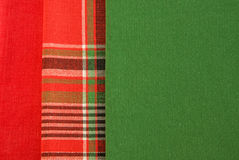 Red, checkered and green fabric. Stock Image
