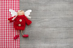Red checkered guardian or christmas angel in country style for a Stock Photo
