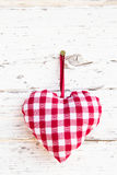 Red checkered heart shape hanging - greeting card - country styl Stock Photos
