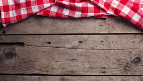 Red  checkered kitchen towel  on vintage  wooden background. Stock Photography