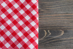 Red checkered napkin on gray wooden table mock up Stock Image