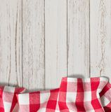 Red checkered picnic tablecloth on white wood table royalty free stock images