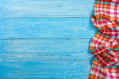 Red checkered tablecloth on a blue wooden table with copy space for your text. Top view Stock Images