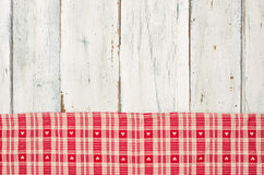 Red checkered tablecloth with hearts on a wooden backgroun Royalty Free Stock Photo