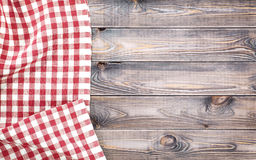Red checkered tablecloth on light wooden table with, top view with copy space.  Royalty Free Stock Images