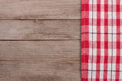 Red checkered tablecloth on an old wooden table with copy space for your text. Top view Stock Photography