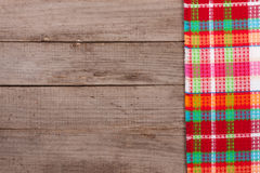 Red checkered tablecloth on an old wooden table with copy space for your text. Top view Stock Images