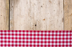 Red checkered tablecloth on a wooden background Stock Photo