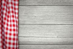 Red checkered tablecloth. On wooden table Stock Image