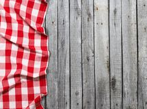 Red checkered tablecloth on wooden table royalty free stock photography
