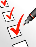 Red Checkmark with Pen. A red pen is checking off boxes which can represent a number of ideas and concepts Stock Photos
