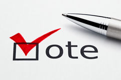 Red checkmark on vote checkbox, pen on ballot