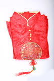 Red cheongsam. A red cheongsam isolated in white background Stock Photo